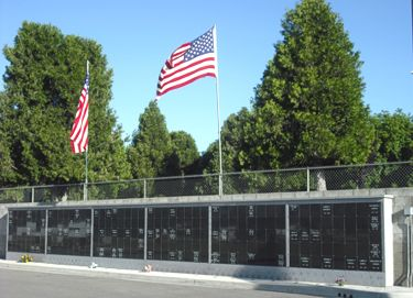 Photograph of Outdoor Cremation Niche Wall and Amercian Flags